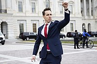 Hawley gives a fist salute to pro-Trump protesters outside of the U.S. Capitol on January 6, 2021. Some of these protesters stormed the Capitol building about an hour later.