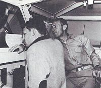 Morrison and his father on the bridge of the USS Bon Homme Richard in January 1964