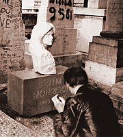 Jim Morrison's grave in Paris decorated with the marble bust (June 1981)