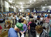 Antiques Roadshow appraises thousands of items in any given taping, with the public ticketed for time slots between 8 am and 5 pm local time; this image shows a portion of the public entering a July 2009 roadshow in Madison, Wisconsin, at noon.