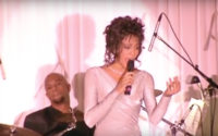 Houston performing at a state dinner in the White House honoring then-South African president Nelson Mandela in 1994