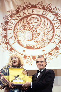 Scorsese receives Golden Lion for Lifetime Achievement from actress Monica Vitti at the Venice Film Festival in 1995