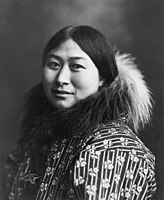 Photograph of Nowadluk/Nowadlook (Nora) Ootenna wearing a parka with a fur-lined hood, c. 1907. Ootenna was an Inupiat woman.