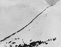 Miners and prospectors climb the Chilkoot Trail during the 1898 Klondike Gold Rush