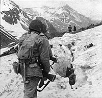 U.S. troops navigate snow and ice during the Battle of Attu in May 1943