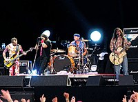 Red Hot Chili Peppers in 2006, showing a quartet lineup for a rock band (from left to right: bassist, lead vocalist, drummer, and guitarist).