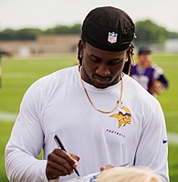 Patterson signing autographs during training camp in 2014