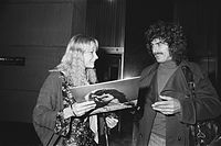 Harrison leaving the Hilton Hotel in Amsterdam, and signing an album for a fan, February 1977