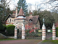 The entrance and gatehouse at Harrison's Friar Park estate. In December 1999, he and his wife Olivia were the victims of a knife attack by an intruder.