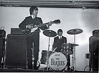 Harrison (left) and Ringo Starr (right) performing at the King's Hall in Belfast, 1964