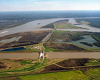 The Old River Control Structure complex. View is to the east-southeast, looking downriver on the Mississippi, with the three dams across channels of the Atchafalaya River to the right of the Mississippi. Concordia Parish, Louisiana is in the foreground, on the right, and Wilkinson County, Mississippi, is in the background, across the Mississippi on the left.