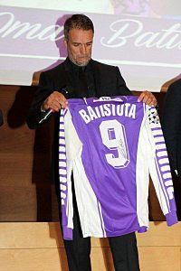 Gabriel Batistuta holding his old number 9 Fiorentina jersey. The number most associated with the position, he was an out and out striker.