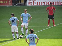 The Edin Džeko and Sergio Aguero duo for Manchester City (2011-15) is a recent example of a striker partnership made up of a taller and more physically imposing player combined with a shorter and technically gifted partner.