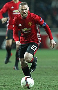 Wayne Rooney, shown wearing the number 10 kit, was used at Manchester United as a second striker on many occasions, playing behind the number 9.