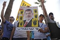 Muslim Brotherhood-affiliated pro-Morsi protesters holding the Rabia sign in a protest in September 2013.
