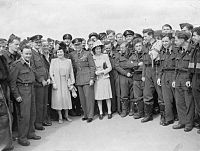 George VI, Queen Elizabeth, and Princess Elizabeth standing with a group of RAF personnel