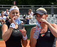 Babos with her doubles partner Mladenovic