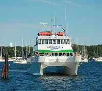 The Salem Ferry, 92 ft. Catamaran is photographed approaching its dock off Blaney Street at the Salem Maritime National Historic Site in Salem, Massachusetts, United States.