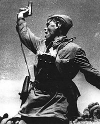 A Soviet junior political officer (Politruk) urges Soviet troops forward against German positions (12 July 1942).