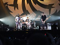 Cornell, Cameron and Shepherd performing with Soundgarden at Lollapalooza 2010
