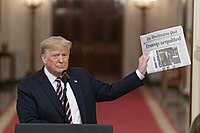 Trump displaying the front page of The Washington Post reporting his acquittal by the Senate