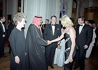 Trump and wife Ivana in the receiving line of a state dinner for King Fahd of Saudi Arabia in 1985, with U.S. president Ronald Reagan and First Lady Nancy Reagan