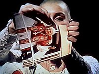 Sinéad O'Connor tears a picture of Pope John Paul II apart during a live SNL performance