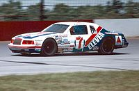 Kyle Petty, driving the 7/Eleven Ford at Pocono in 1985
