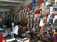 Neighbourhood grocery shops handle much of retail trade in India.