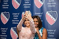 Lopez and First Lady Michelle Obama posing for a selfie at the League of United Latin American Citizens National Convention and Exposition in 2014