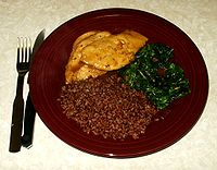 Traditional dish with lemon glazed chicken, sauteed spinach and steamed Bhutanese red rice