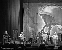 CSNY during their 2006 tour; L to R: Graham Nash, Tom Bray, Stephen Stills, Neil Young, Rick Rosas, and David Crosby