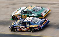 No. 14 Marlin battles No. 55 Michael Waltrip at the 2006 spring Bristol race.
