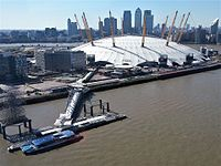 The O2 in 2012, with Canary Wharf in the background