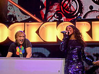 David Guetta and Rowland performing at the Orange Rockcorps in London in 2009.