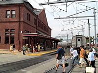 Passengers crossing the State Street crossing in New London after departing a northbound train