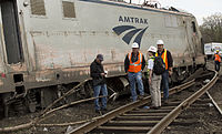 NTSB officials inspect the derailed locomotive 601