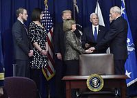 Pence swears in John F. Kelly at DHS Headquarters on January 25, 2017.