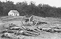 The Dunker Church after September 17, 1862. Here, both Union and Confederate dead lie together on the field.