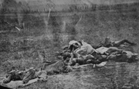 "<center>Dead on Antietam battlefield<ref>Site identified by Robert Kalasky, ""Military Images"" Volume XX, Number 6 May–June 1999, pp. 24&ndash;29.</ref></center>"