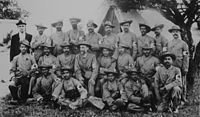 Gandhi with the stretcher-bearers of the Indian Ambulance Corps during the Boer War.
