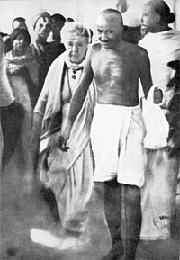 Gandhi with Dr. Annie Besant en route to a meeting in Madras in September 1921. Earlier, in Madurai, on 21 September 1921, Gandhi had adopted the loin-cloth for the first time as a symbol of his identification with India's poor.