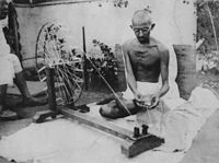 Gandhi spinning yarn, in the late 1920s
