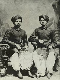 Gandhi (right) with his eldest brother Laxmidas in 1886.