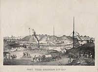 Yuma and Fort Yuma across the Colorado River (circa 1875 lithograph). Steamboat is downriver from the ferry crossing that is equipped with masts on both banks to raise the ferry's tow cables above the smokestacks of passing steamboats. Note two of the cables holding the mast up are tied to discarded boilers, presumably taken out of George A. Johnson & Company or Colorado Steam Navigation Company (C.S.N.C) steamboats when they were rebuilt or dismantled here.