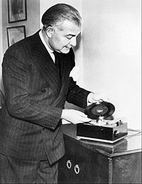 Boston Pops conductor Arthur Fiedler demonstrating the new RCA Victor 45 rpm player and record in February 1949.