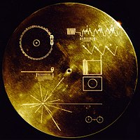 The protective cover of the one-off Voyager Golden Record, containing symbolic information on how it is to be played on the top-left of the label.