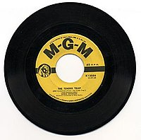 45 rpm records, like this single from 1956, usually had a chosen A-side, for radio promotion as a possible hit, with a flip side or B-side by the same artist – though some had two A-sides.