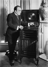 Enrico Caruso with a phonograph c.1910s