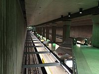 The B Line and D Line subway platforms as seen from the mezzanine level.
